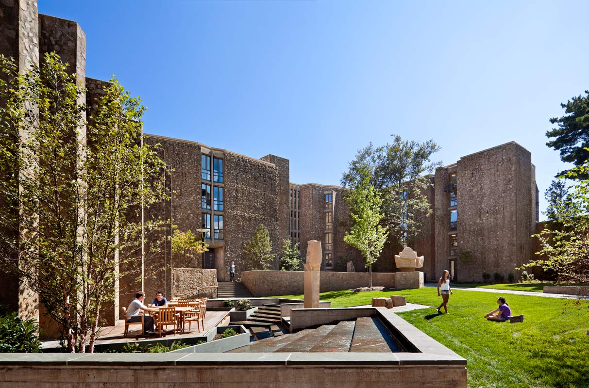 <p>New site walls terrace the courtyard and negotiate the grade down to the main entry and dining hall. A water feature and deck are popular with students. <br><small>&copy; Peter Aaron/OTTO</small></p>