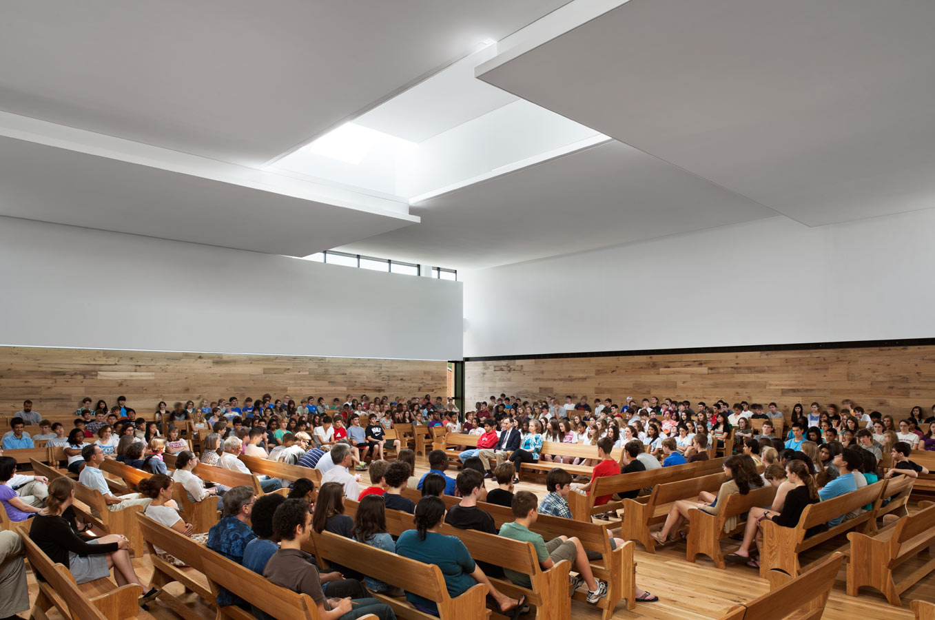 <p>The Meeting House is designed to filter light, views, and sounds from the surge of activity around the center of the campus. Panels on the ceiling are arranged in a pinwheel pattern around a central skylight, a void of light around which form and order are created. <br><small>&copy; Michael Moran/OTTO</small></p>