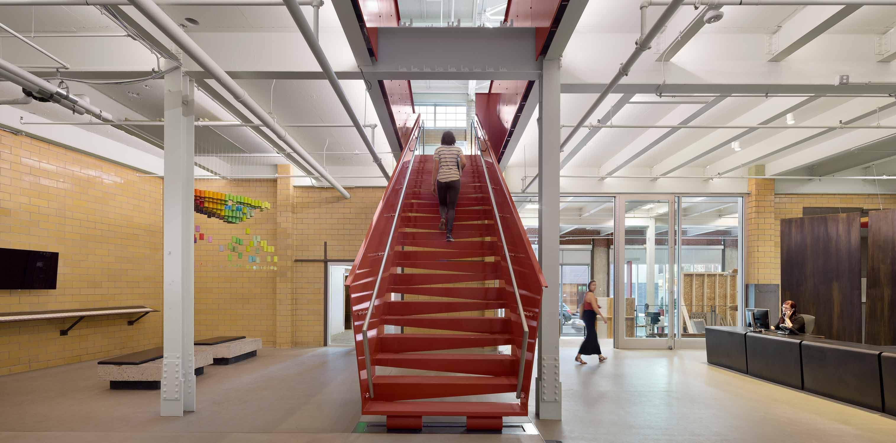 <p>An all-steel stairway greets visitors on the first floor, which is also used for hosting research activities, office meetings, events, and exhibits.<br> <br /><small>©Michael Moran</small></p>