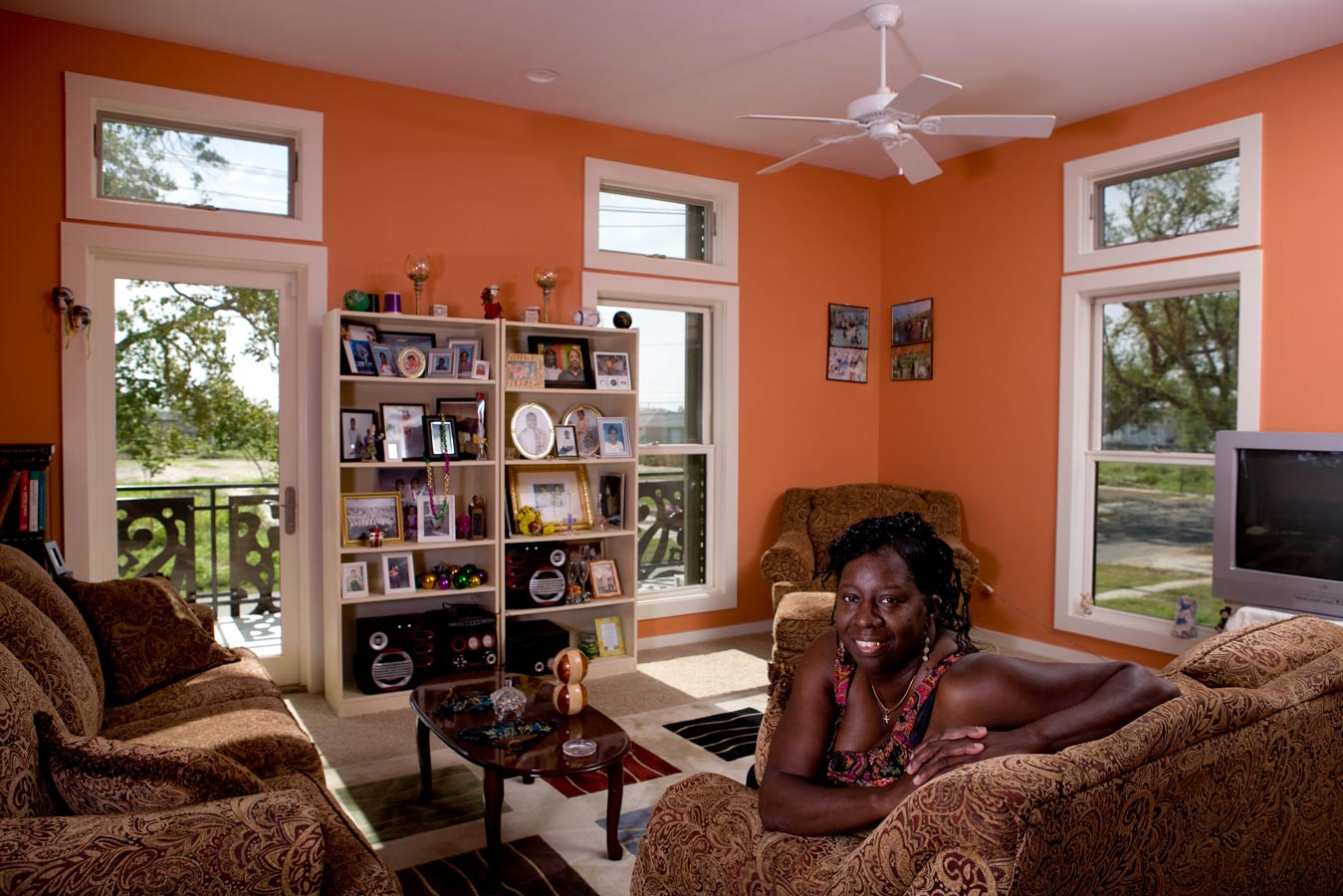 <p>Melba Barnes, the first owner of a KieranTimberlake house in the Lower Ninth Ward, in her completed home on Tennessee Street. Barnes lost her previous home in Hurricane Katrina. <br><small>© Alexei Lebedev/Momenta</small></p>