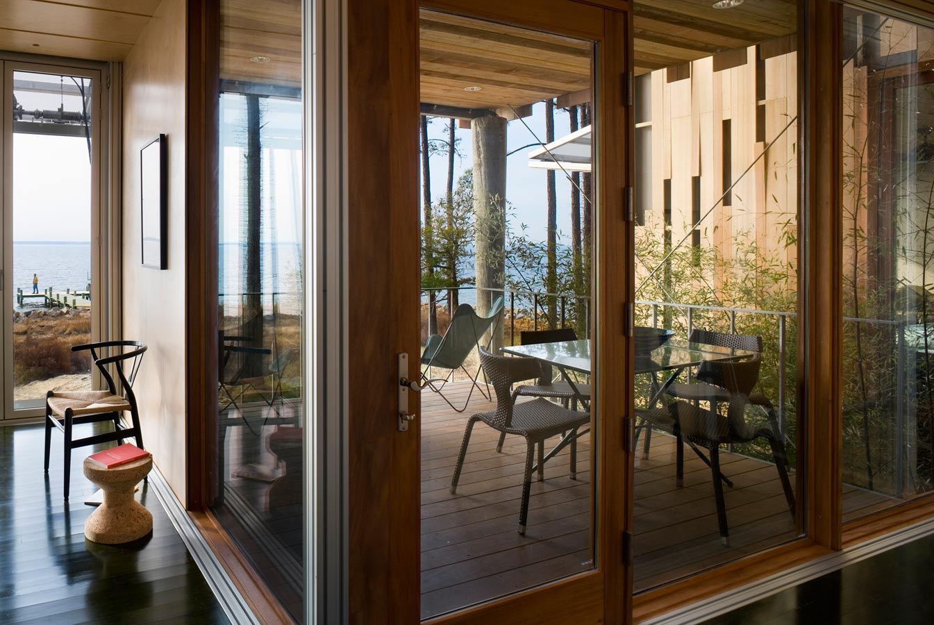 <p>The covered deck outside the master bedroom, with bamboo garden and guest wing beyond. <br><small>&copy; Peter Aaron/OTTO</small></p>