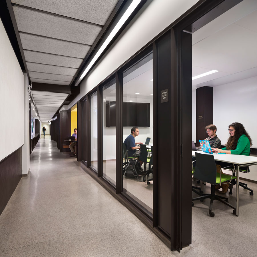 <p>A transparent meeting room along the new social corridor at the basement level activates the corridor and encourages impromptu interactions. <br> <br /><small>© Michael Moran/OTTO</small></p>