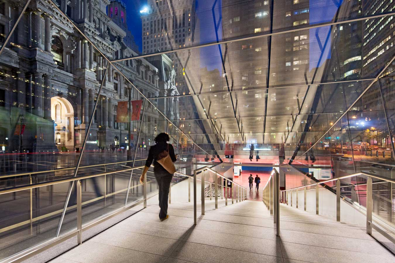 <p>Self-cleaning, shatterproof glass, and graffiti-resistant film help to protect and maintain the entryway pavilions to underground transit. <br><small>© James Ewing Photography</small></p>