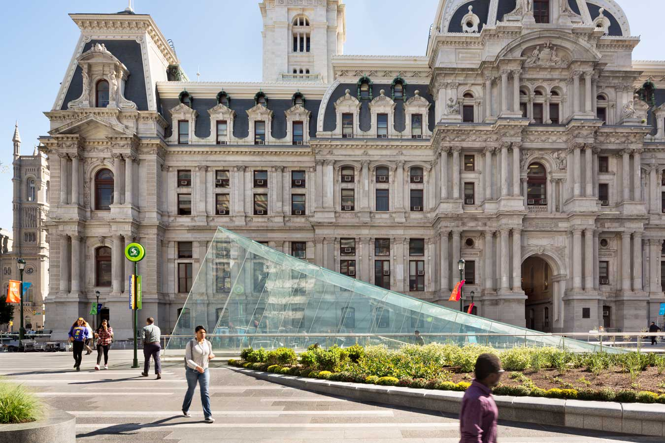 <p>The landscape and architecture work together to enhance and frame the views of City Hall, providing a renewed sense of place and arrival. <br><small>© James Ewing Photography</small></p>