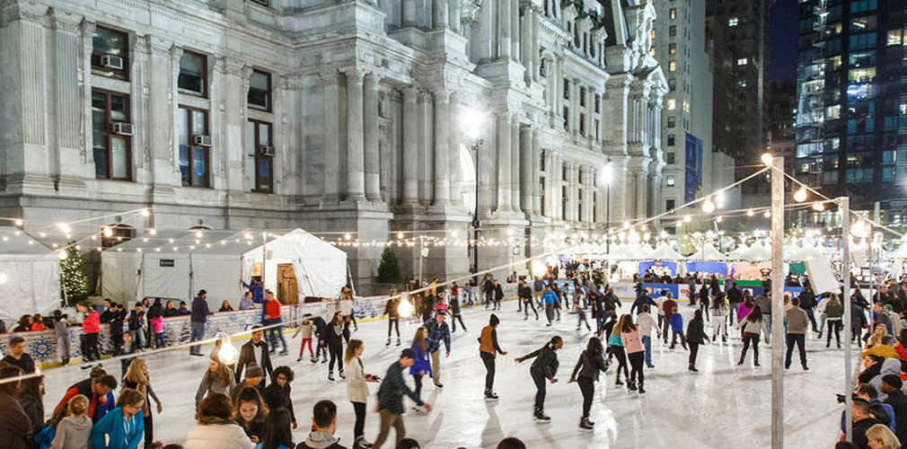 <p>During winter months, an ice rink operates over the fountain and draws visitors to the newly revitalized park. <br><small>Photo courtesy Center City District</small></p>