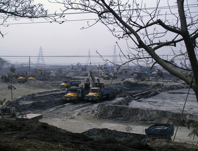 A sand depot reflects the volume of sandfilling operations near Dhaka.