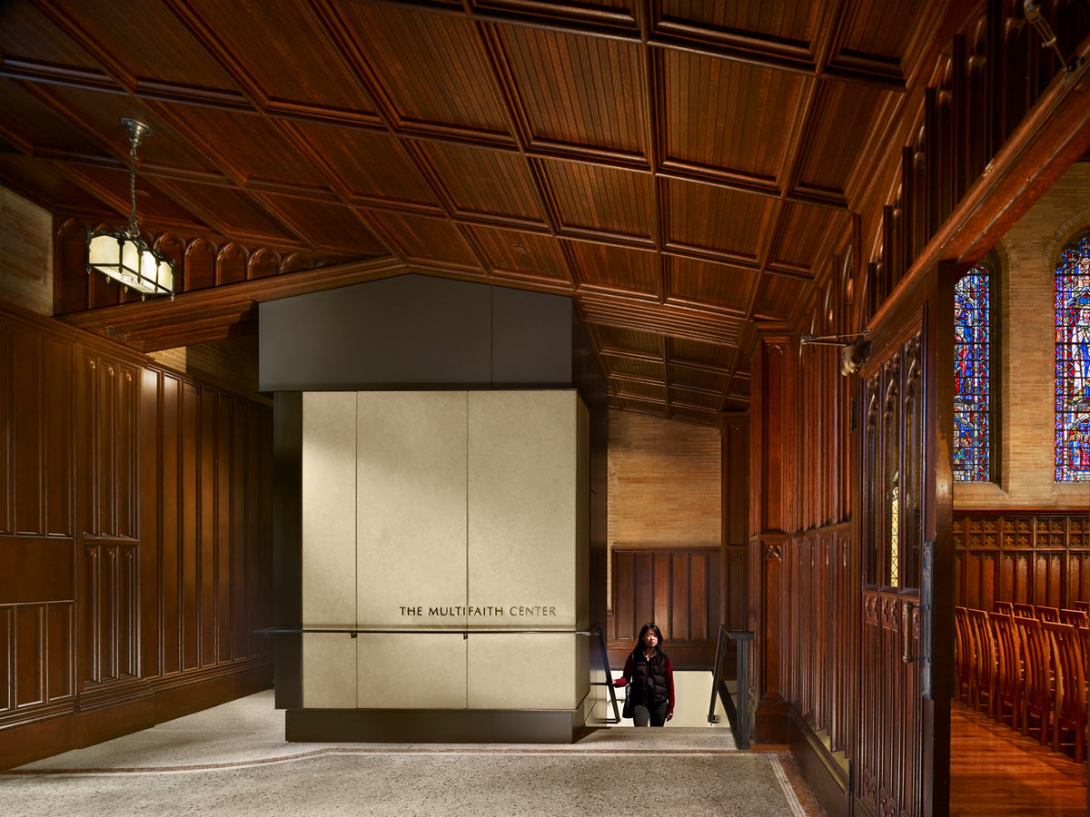 <p>An elevator bay added in the narthex respects the existing ornate wood through the use of Kasota stone and bronze details and makes the Multifaith Center below ground more accessible. <br><small>© Halkin Photography LLC</small></p>