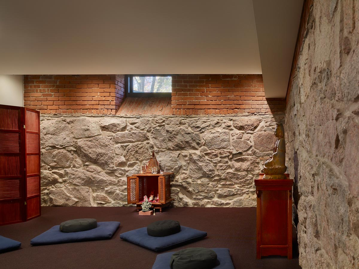 <p>The meditation room is a quiet space enclosed by the original walls of the crypt. <br><small>© Halkin Photography LLC</small></p>