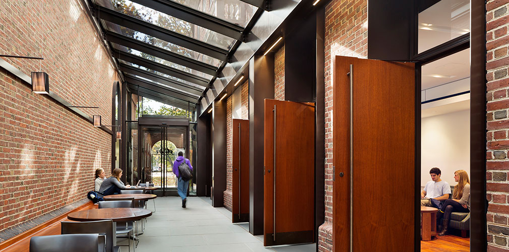 <p>The insertion of a light court to transform a dark alleyway between the residential hall and the dining hall was a pivotal addition. <br><small>© Michael Moran/OTTO</small></p>