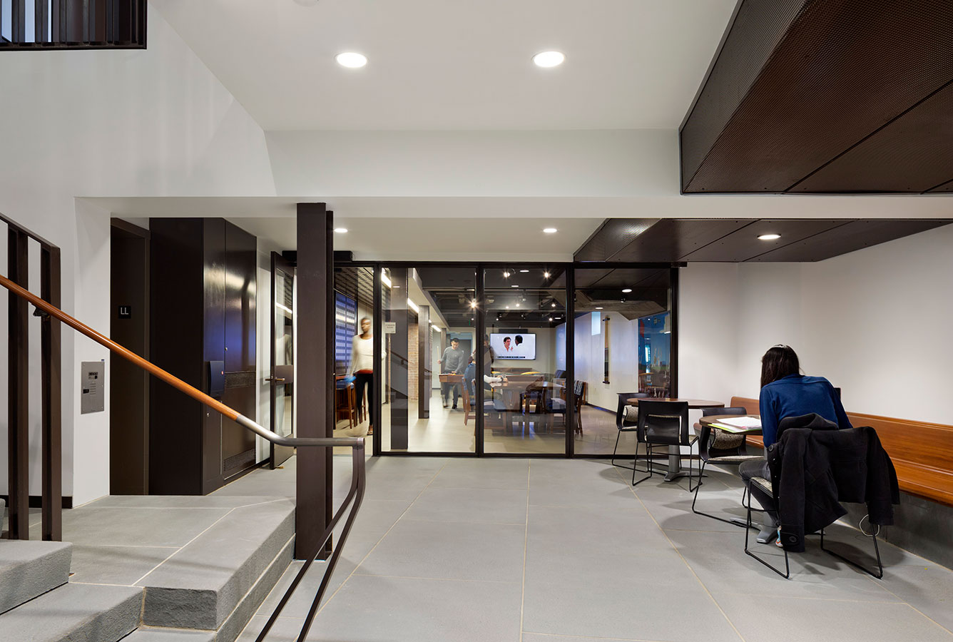 "<p>A lower-level area that students have nicknamed the ""rabbit hole"" (the rabbit is the house mascot) includes an informal lounge and entertainment room and a student kitchen. <br><small>© Michael Moran/OTTO</small></p>"