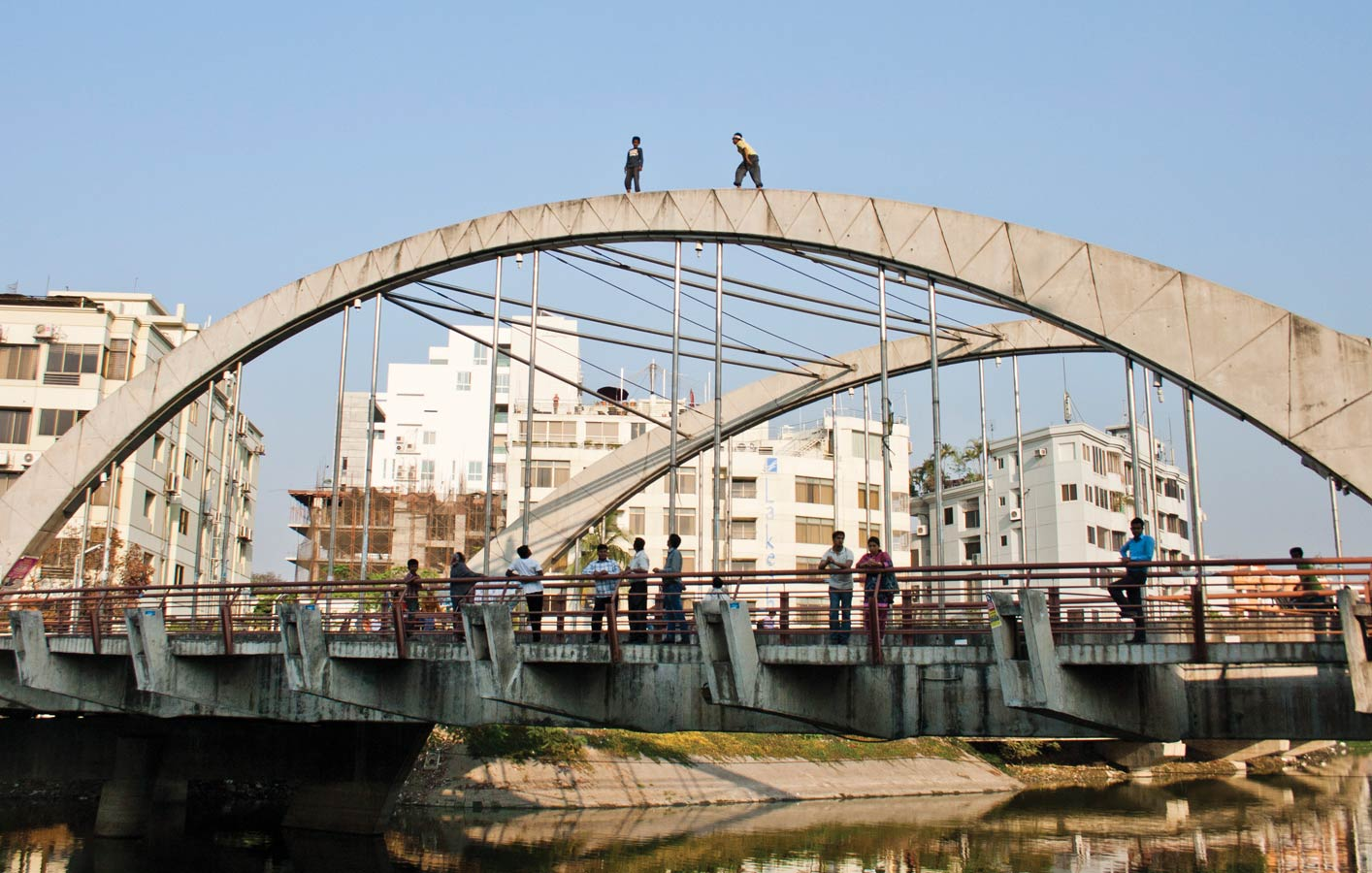 <p>Boys climb atop Banani Bridge near Korail slum.</p>