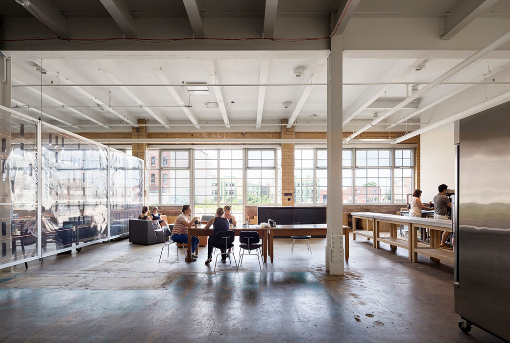 <p>Collaborative spaces are incorporated throughout the building, including in the first floor kitchen.  <br /> <br><small>© Michael Moran/OTTO</small></p>