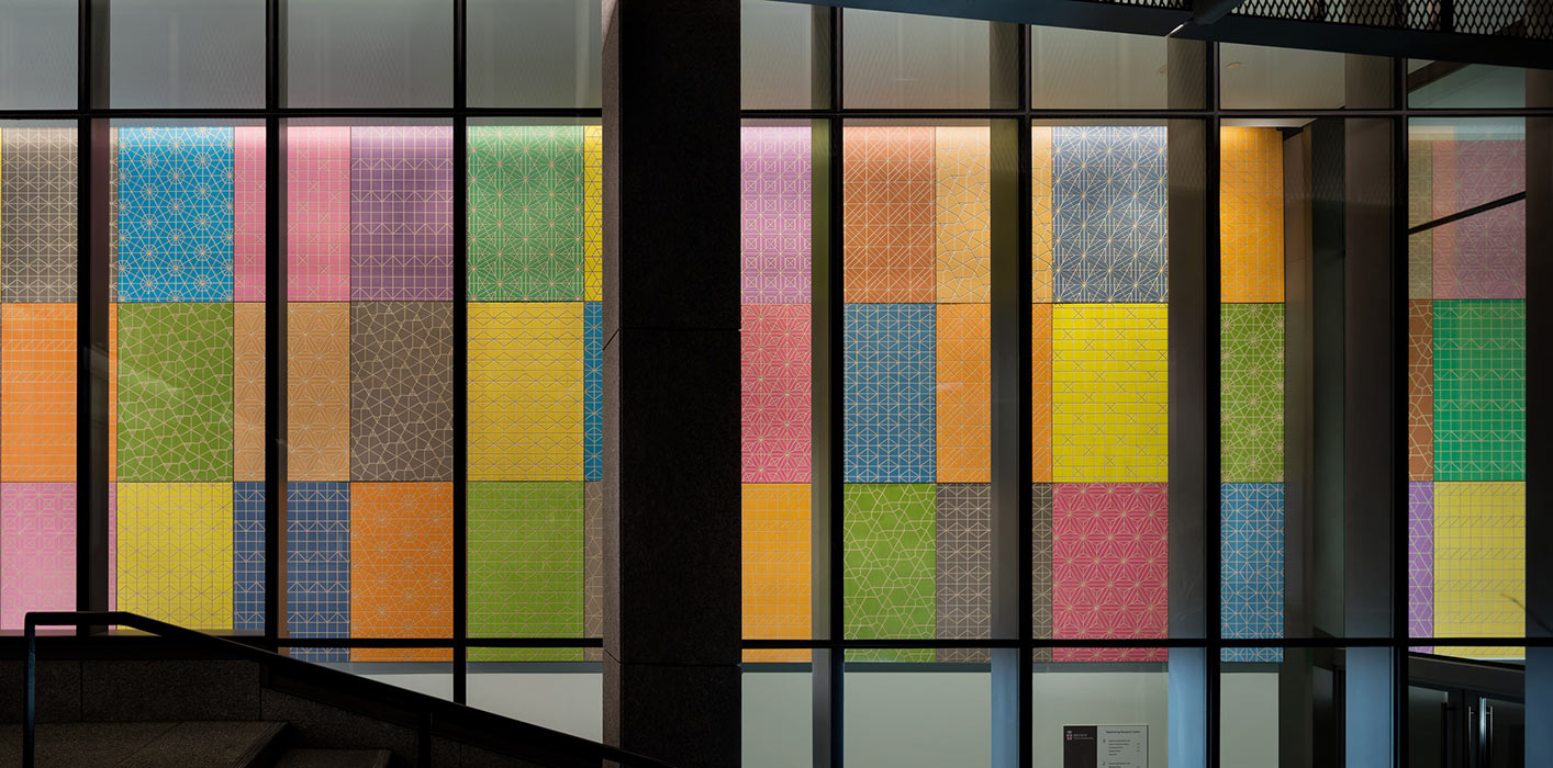 <p>The centerpiece of Spencer Finch's artwork is a dyed and engraved plywood installation that hangs in a ground-level corridor and is visible from the exterior. <small>&copy;Warren Jagger</small></p>