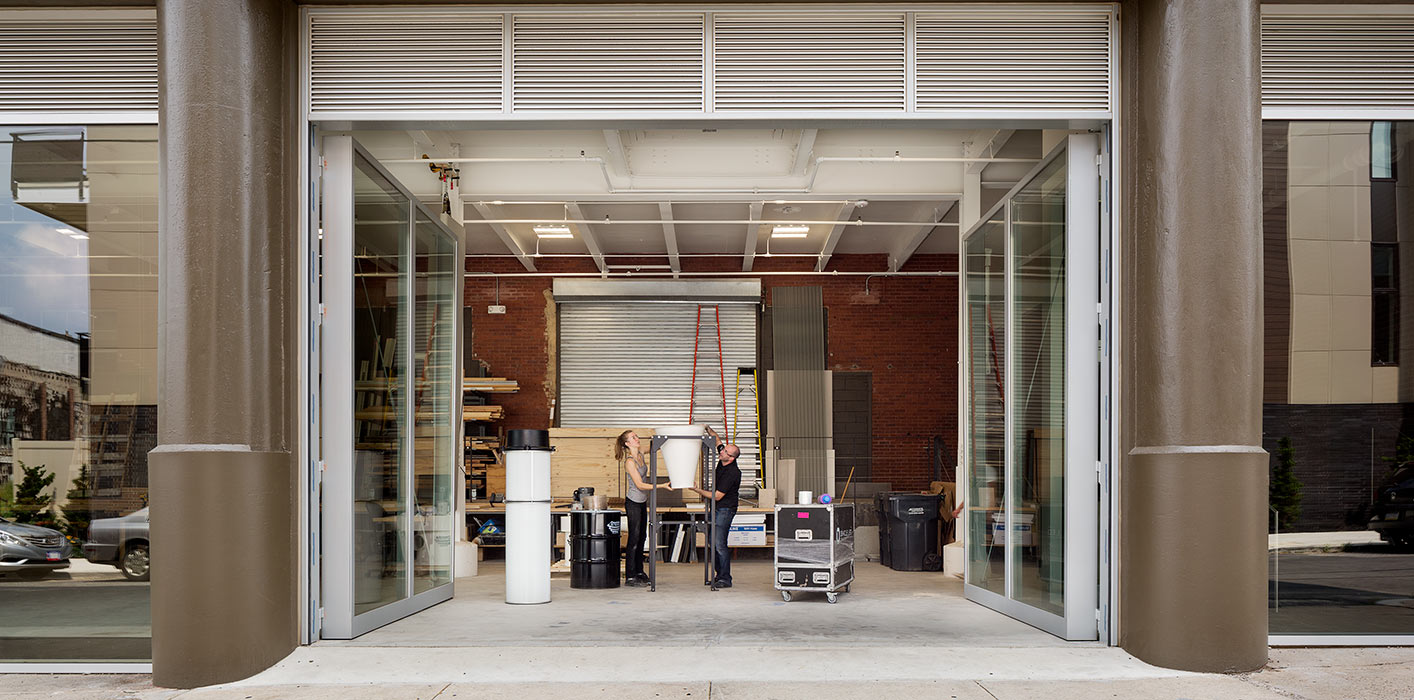 <p>The workshop's 13-foot-high glass doors open onto the street to allow full-size mock-ups and large materials to be moved in and out of the building.&nbsp;<br /><small>&copy; Michael Moran/OTTO</small></p>
