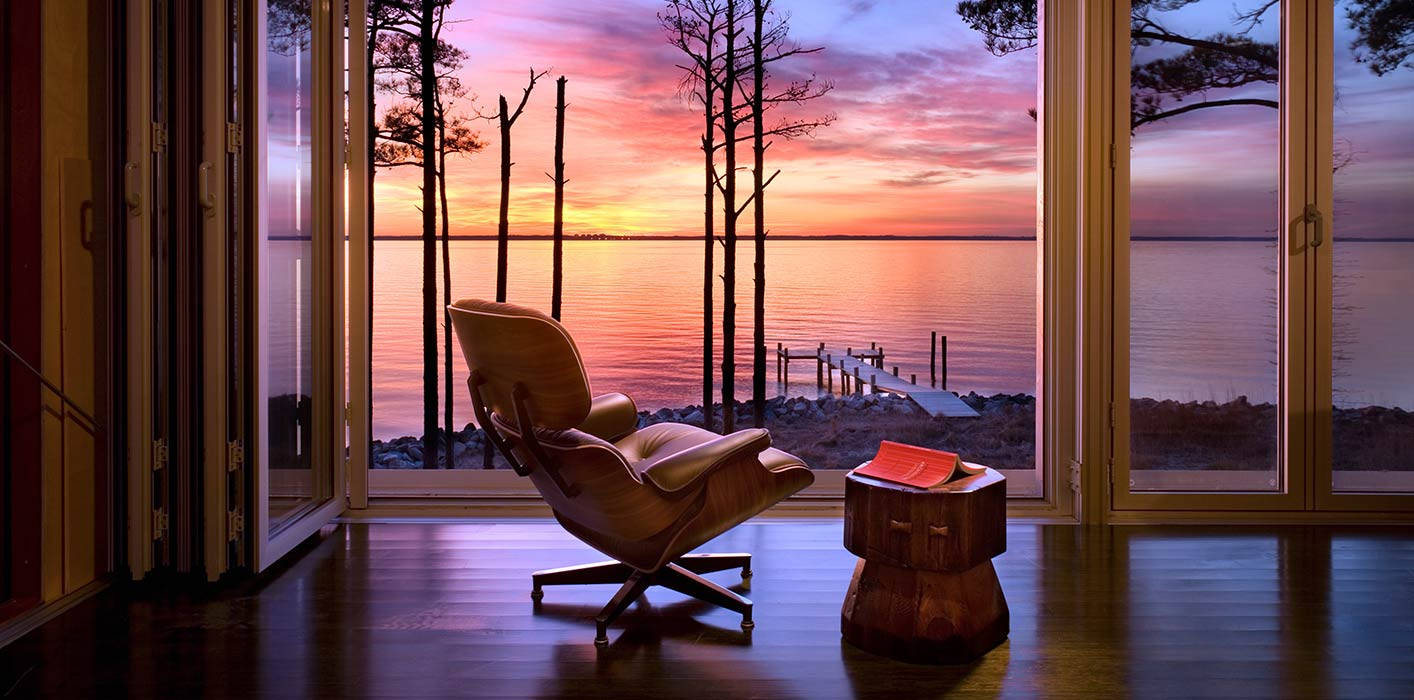 <p>A view from the interior of Loblolly House overlooking the Chesapeake Bay at sunset. <br><small>&copy; Peter Aaron/OTTO</small></p>