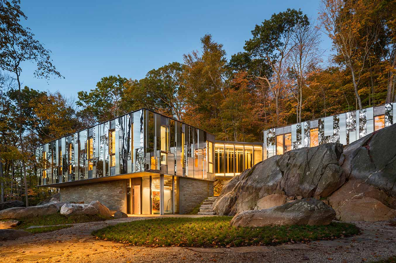 <p>At Pound Ridge House, most of the windows extend from floor to ceiling, parting the wall to reveal framed views to moments in the geology. The metal rain screen wall panels, in turn, reveal their own abstractions of the landscape. <br><small>&copy; Peter Aaron/OTTO</small></p>