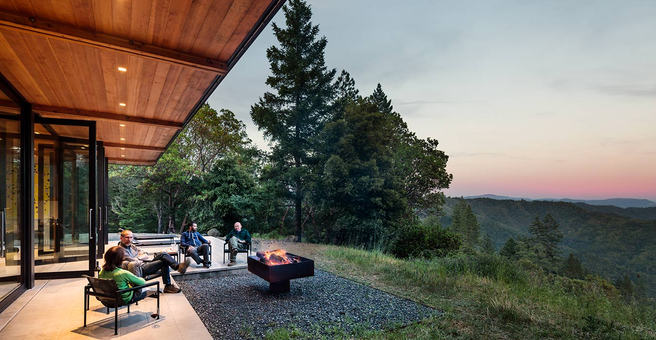 <p>A patio and fire pit are an outdoor room overlooking the canyon below. <br><small>&copy;Tim Griffith</small></p>