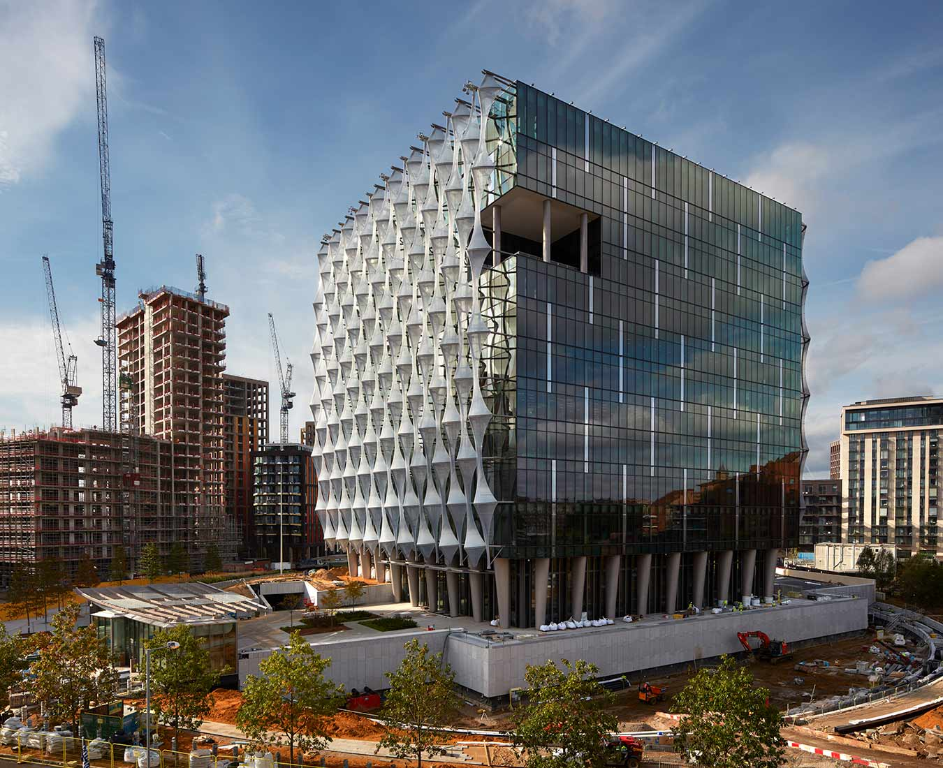 <p>Pictured near the end of construction in 2018, the Embassy's transparent cube sits atop a colonnade that gives the building a beacon-like quality.<small><br> ©Richard Bryant</small></p>